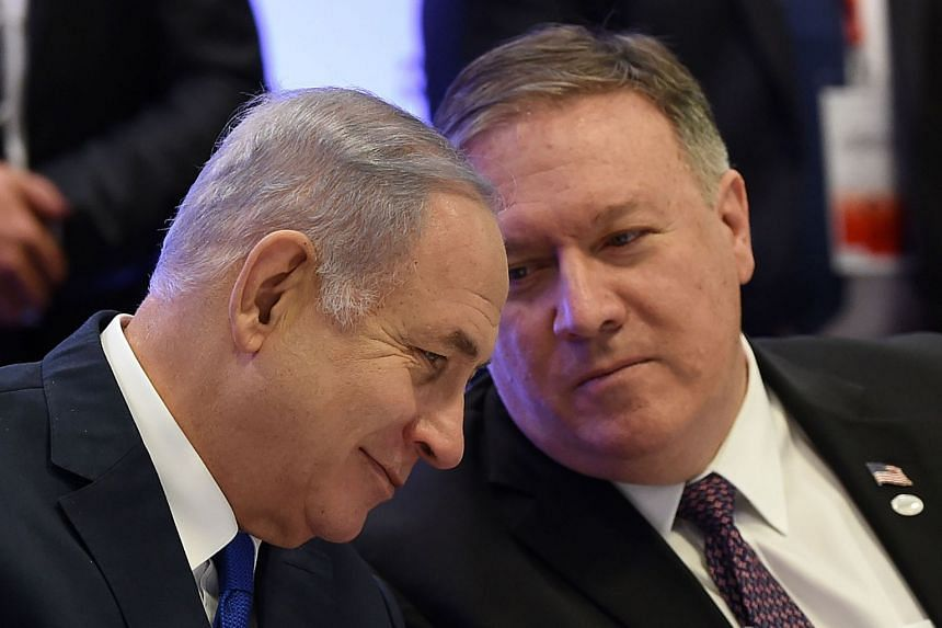 Mike Pompeo (right) talking to Israel's Prime Minister Benjamin Netanyahu at the Warsaw conference.