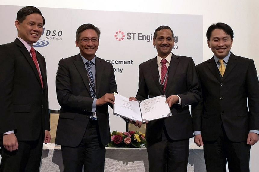 From far left: Minister for Trade and Industry Chan Chun Sing, DSO National Laboratories chief executive Cheong Chee Hoo, ST Engineering Electronics president Ravinder Singh, and ST Engineering president and CEO Vincent Chong at the signing of an agr