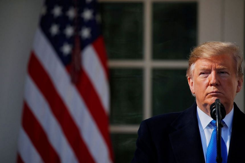 US President Donald Trump pauses during his declaration of a national emergency at the US-Mexico border.