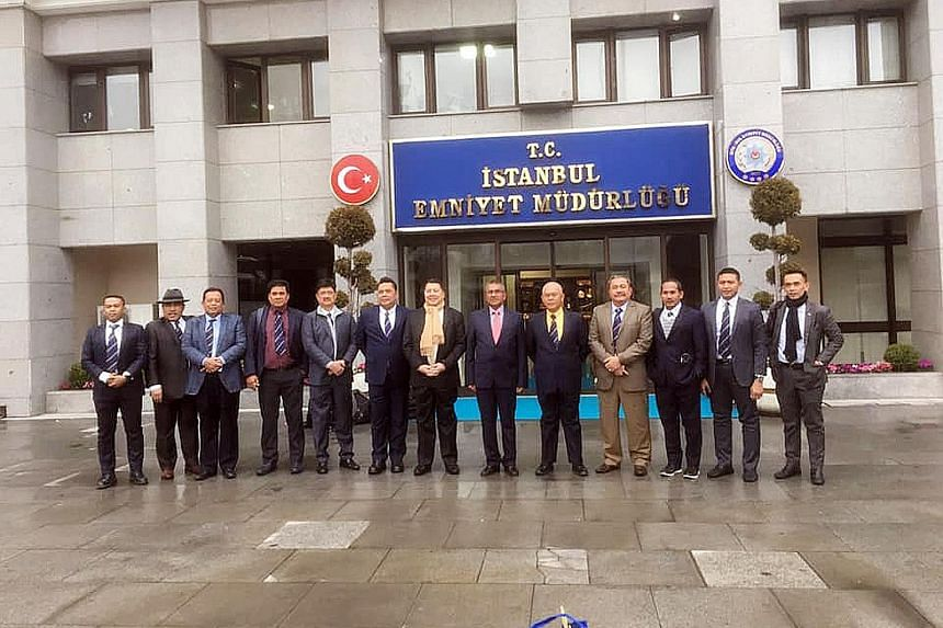 Malaysian police chief Mohamad Fuzi Harun (sixth from right) and senior officers in front of the Istanbul police headquarters.