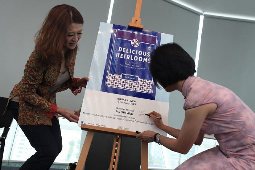 Ms Sim Ann, Senior Minister of State for Communications and Information, and for Culture, Community and Youth, and Ms Ow Kim Kit, author of Delicious Heirlooms, at the launch of the book at the National Library on Feb 16, 2019.