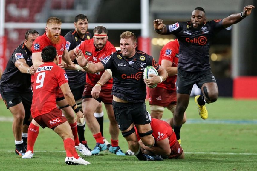 Cell C Sharks' Tyler Paul being pursued and tackled by players from Hito-Communications Sunwolves during their Super Rugby match at the National Stadium on Feb 16, 2019.