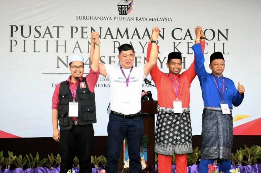 Semenyih by-election candidates (from left) Parti Sosialis Malaysia's Nik Aziz Afiq Abdul, independent candidate Kuan Chee Heng, Pakatan Harapan's Muhammad Aiman Zainali and Barisan Nasional's  Zakaria Hanafi.