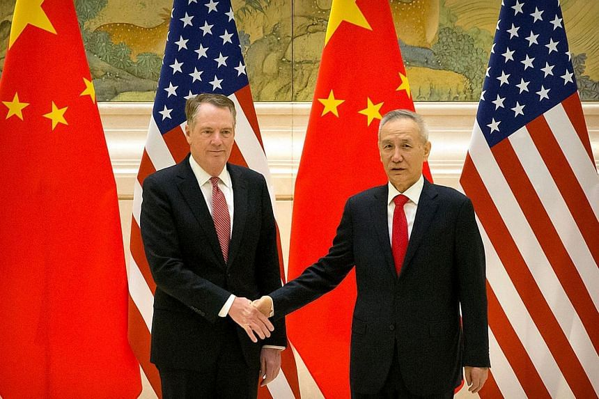 US Trade Representative Robert Lighthizer and Chinese Vice-Premier and lead trade negotiator Liu He before the opening session of trade negotiations at the Diaoyutai State Guesthouse in Beijing on Feb 14, 2019.