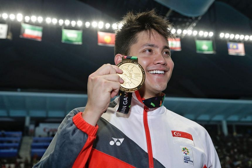 Joseph Schooling with the men's 50m butterfly gold medal at the 18th Asian Games in Gelora Bung Karno Aquatic Centre, Jakarta, Indonesia, on Aug 23, 2018.