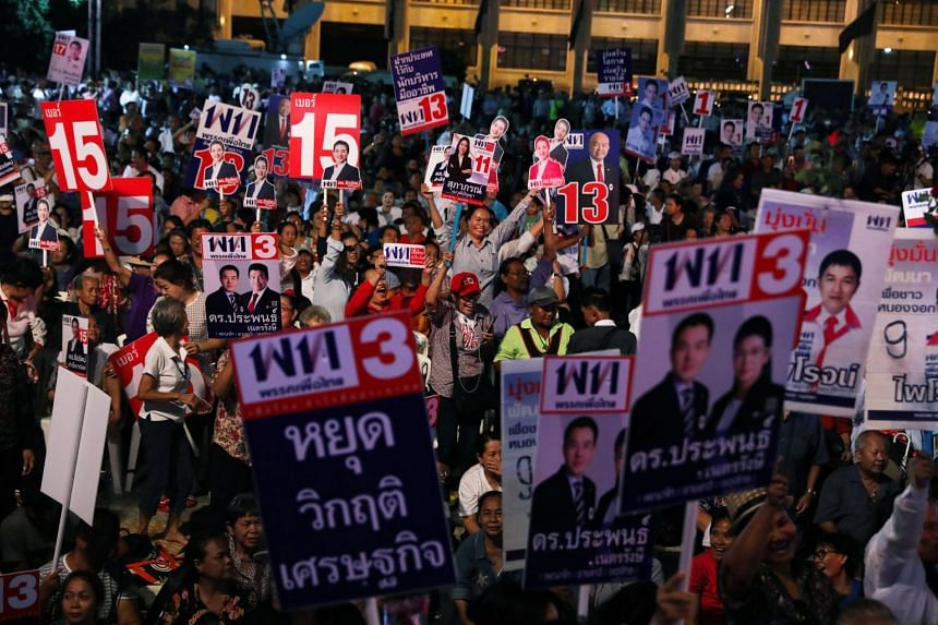 Supporters of Pheu Thai Party attend the election campaign in Bangkok on Feb 15, 2019.