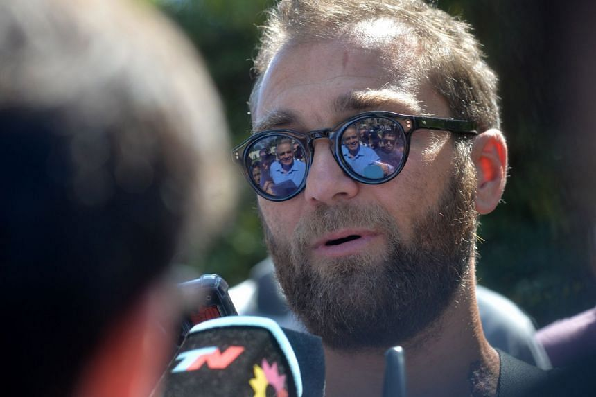 Former Argentinian soccer player Nicolas Higuain speaks with journalists as he attends the funeral.