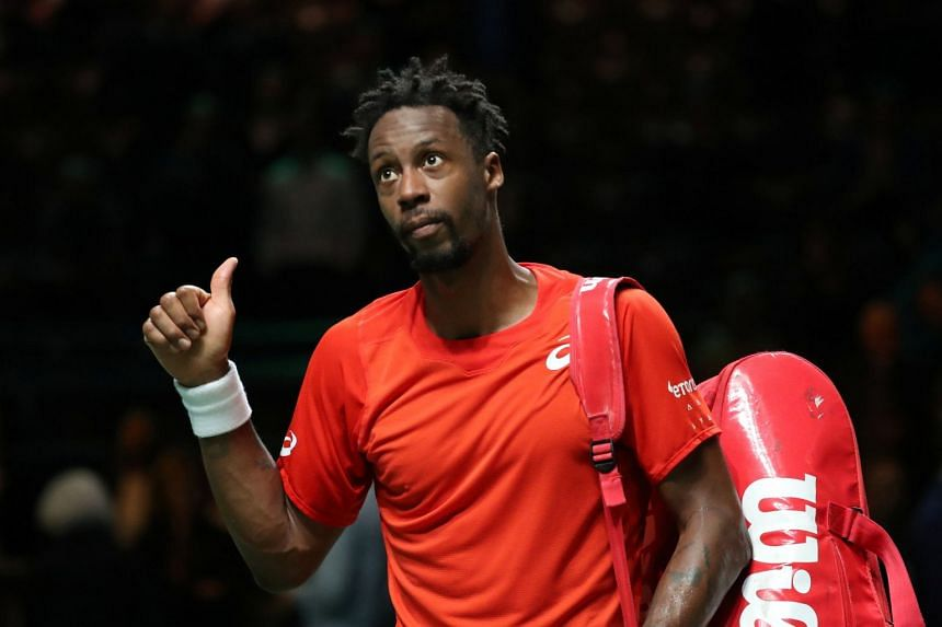 Monfils gestures to the fans after winning against Russia's Daniil Medvedev.