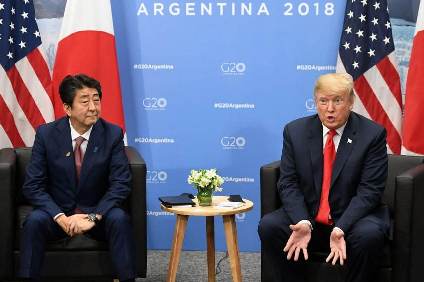 """A spokesman for Japan's Foreign Ministry in Tokyo said the ministry was aware of US President Donald Trump's remarks, but """"would refrain from commenting on the interaction between the two leaders""""."""
