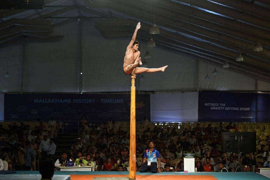 The pole is eight and a half feet (2.6m) in height. It is smooth, well polished and tapered at the top. Different acrobatic exercises and yogic postures are performed on it.
