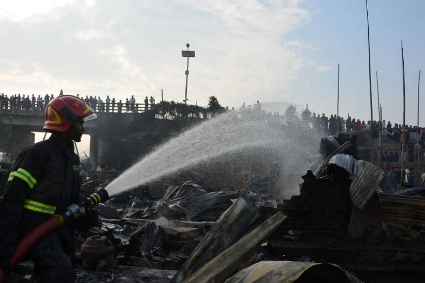 A firefighter working to extinguish a fire in a slum in Chittagong, Bangladesh, on Feb 17, 2019.