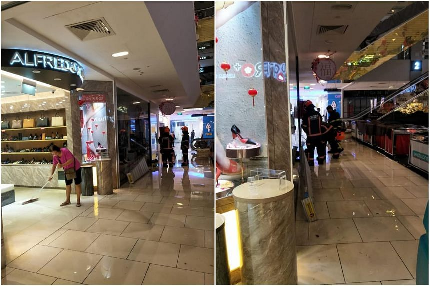 One shopkeeper could be seen attempting to sweep water out from her shop as SCDF officers attended to Geox, the neighbouring shop.
