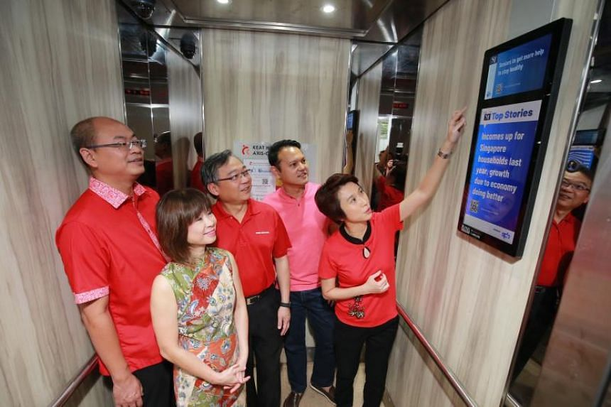 (From left) MPs Yee Chia Hsing, Amy Khor, Gan Kim Yong, Zaqy Mohamad and Low Yen Ling taking a look at one of the LED screens that was installed to improve communications with residents in the area.