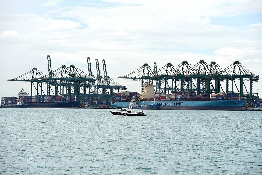 Container ships at the Pasir Panjang terminal port. Trade-dependent Singapore's non-oil domestic export and balance of trade numbers are due early today, and will offer insight into how heavily trade tensions are impacting the local economy.