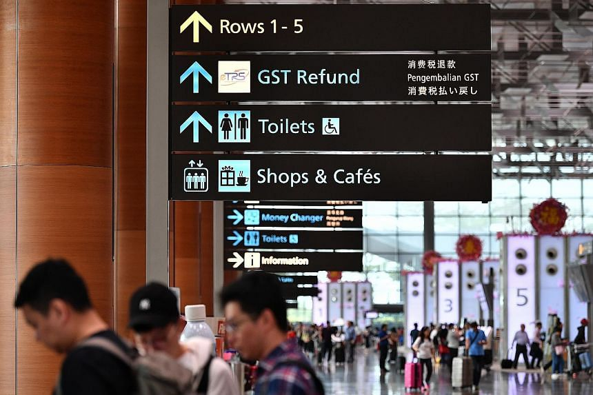 Disparities in the usage of Tamil across Chang Airport's various terminals seem to suggest an inconsistency. In Terminals 2 (left) and 4, directional signs are in all four official languages - English, Chinese, Malay and Tamil - as well as in Japanes