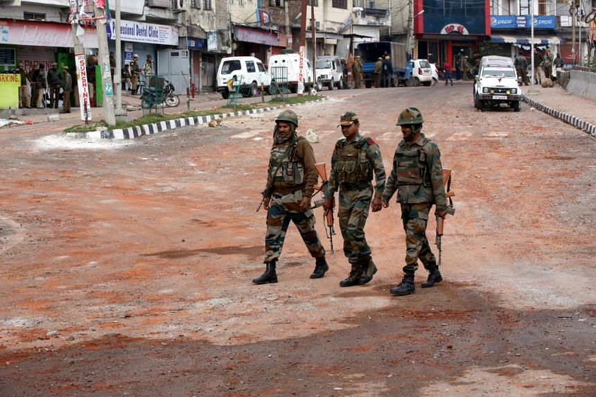 Indian army soldiers patrol during curfew in Jammu, the winter capital of Kashmir, India on Feb 17, 2019.