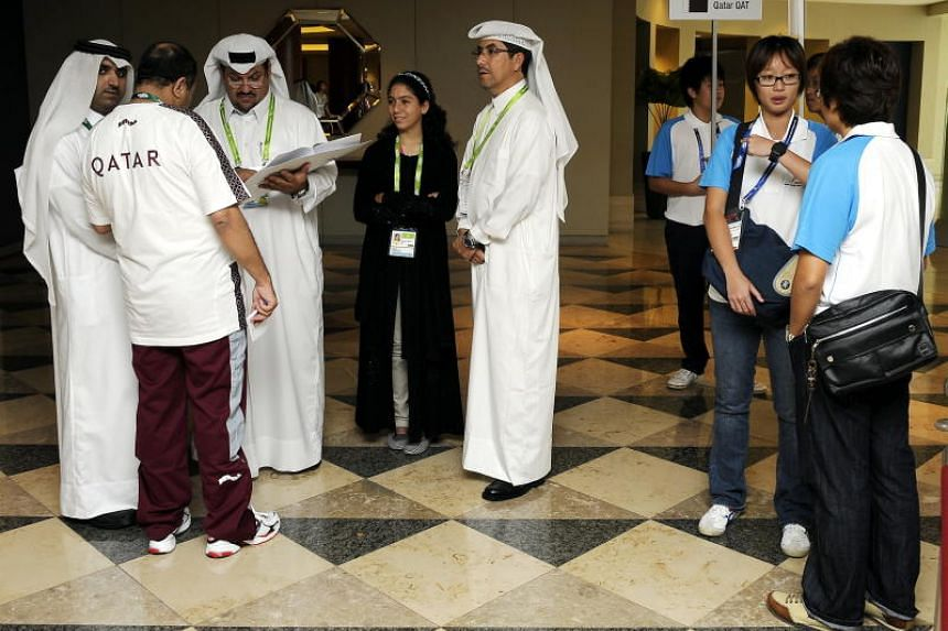 Officials of the Qatar contingent at the lobby of the Swissotel The Stamford for the 2009 Asian Youth Olympics in Singapore.