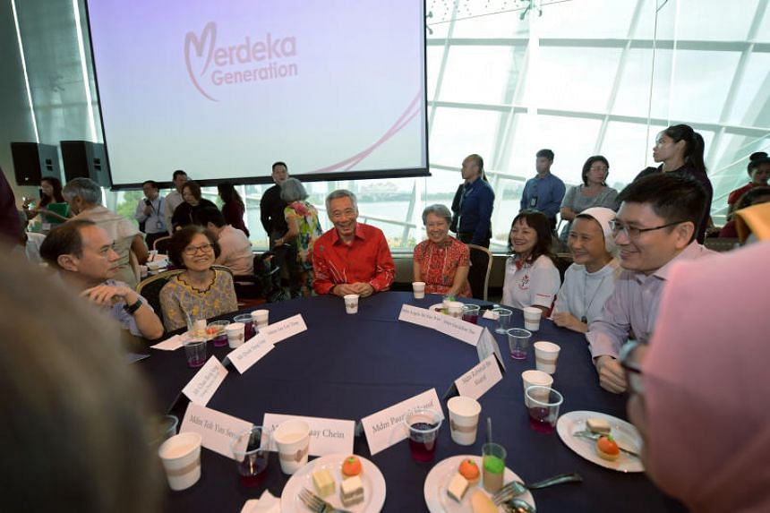Prime Minister Lee Hsien Loong and his wife Mrs Lee with guests at a tribute event for the Merdeka Generation at Gardens by the Bay on Feb 2, 2019.