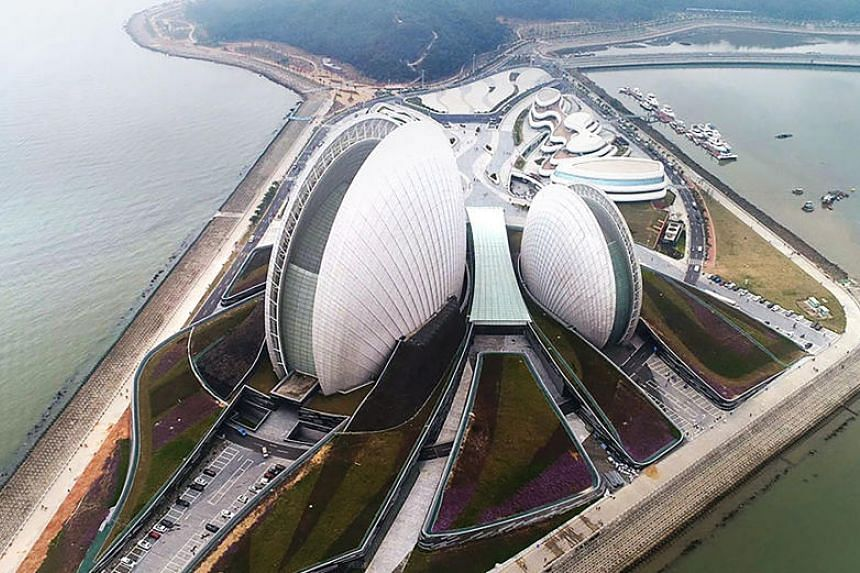 The scallop-shaped Zhuhai Grand Theatre. It is designed in the shape of two shells – one at 90 metres high and one at 60 metres high. They imply the scallop gives birth to a pearl while the sea gives birth to a scallop, which leads to the name Zhuh