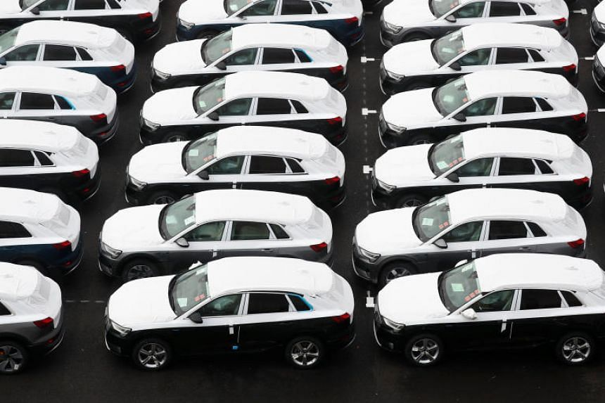 Cars outside an assembly plant in Brussels, Belgium, on Feb 12, 2019.