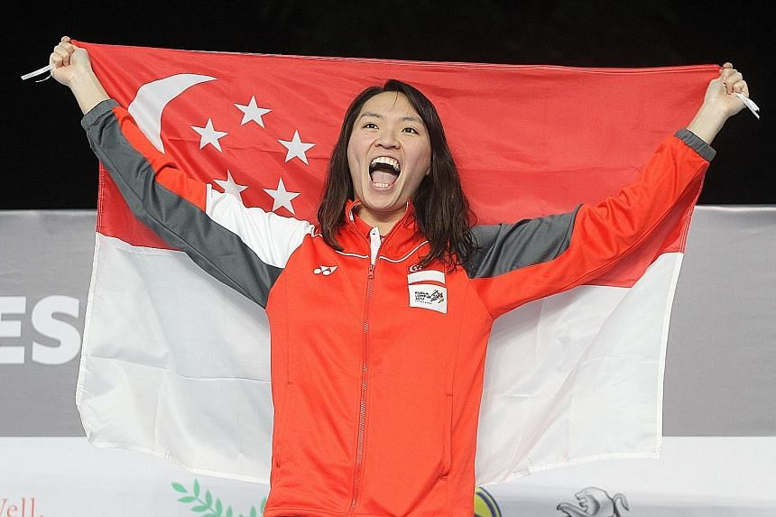 Roanne Ho raising the national flag after winning the 50m breaststroke gold in 31.29sec, a SEA Games record, in Kuala Lumpur 2017.