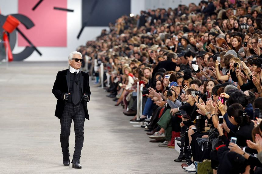 Karl Lagerfeld, who simultaneously churned out collections for LVMH's Fendi and his eponymous label - an unheard of feat in fashion - was almost a brand in his own right.