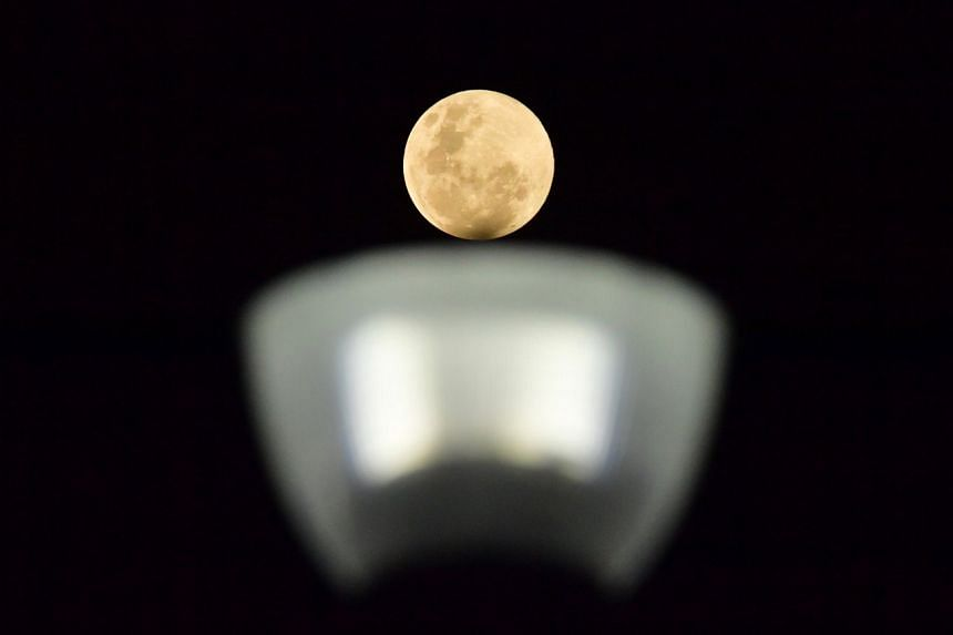 The Supermoon on top of a street lamp at Bedok Jetty on Feb 19, 2019.