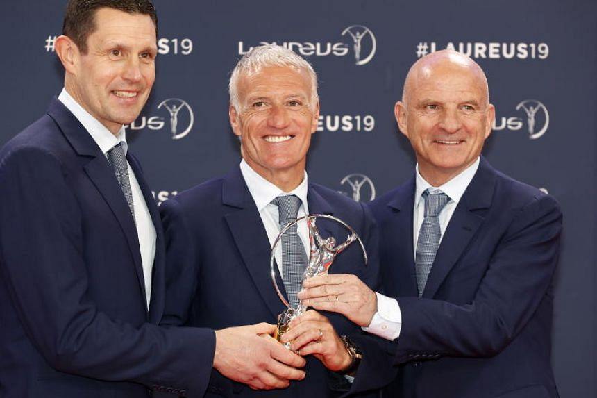 France's national football team manager Didier Deschamps (centre) with assistant coach Guy Stephan (right) and goalkeeper coach Franck Raviot collected the team of the year prize.