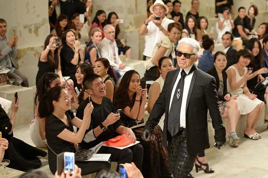 Karl Lagerfeld (walking the runway) taking his bow after the parade of 80 looks from the Chanel cruise 2013/2014 collection at Loewen Cluster, a heritage site in Dempsey Hill, on May 9, 2013.