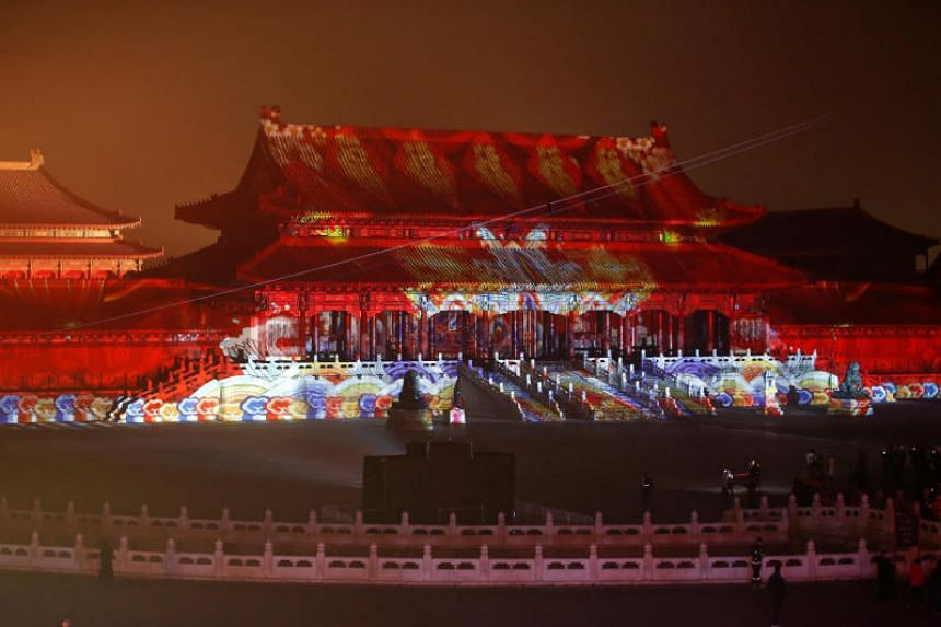The Forbidden City is projected with lights during a light show to celebrate the Chinese Lantern Festival on the last day of the Chinese New Year celebrations in Beijing on Feb 19, 2019.