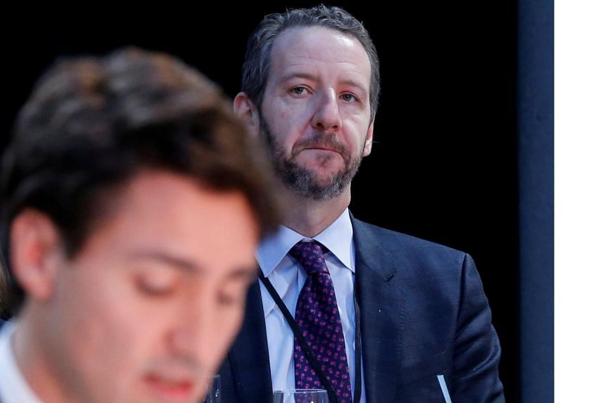 Principal secretary Gerald Butts listens as Prime Minister Justin Trudeau speaks during a meeting in Ottawa, Canada, in 2016.