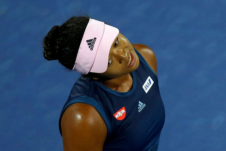 Osaka reacts during her second round match against Kristina Mladenovic of France.