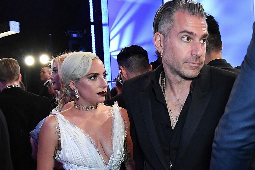 Actress-singer Lady Gaga, seen here with her fiance Christian Carino at the Screen Actors Guild Awards last month, was recently spotted without her engagement ring.