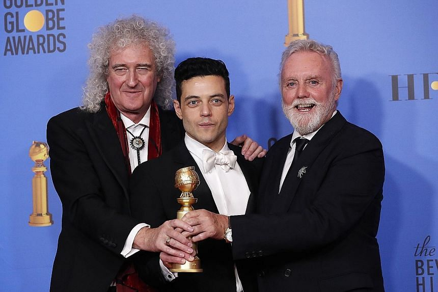 Queen's Brian May (far left) and Roger Taylor (left), seen here with Bohemian Rhapsody star Rami Malek in California last month, will perform at the Oscars ceremony on Sunday with former American Idol star Adam Lambert (above) on vocals.