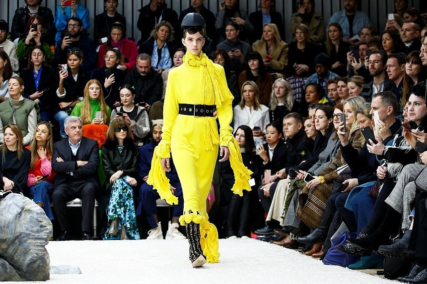 (Above) Roksanda Ilincic's long, fluid dresses nonchalantly tied at the waist or shoulder evoked the style of the Roman toga. (Left) A mixture of leather and studding defined JW Anderson's autumn/winter 2019 collection.