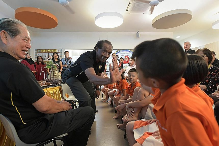 Retired First Warrant Officer Mohamed Haniffa Jainul Abitheen, 72, and retired Lieutenant-Colonel Bob Cheah, 78, at a story-telling session for pre-schoolers at the My First Skool centre in Jurong West Street 65 yesterday, as part of the pre-school's