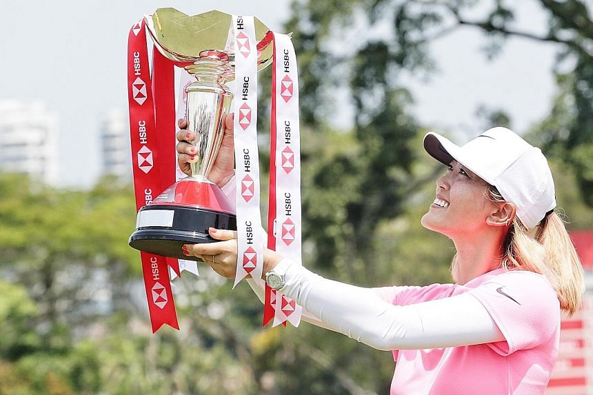 American golfer Michelle Wie enjoying the moment after winning last year's HSBC Women's World Championship at Sentosa Golf Club.