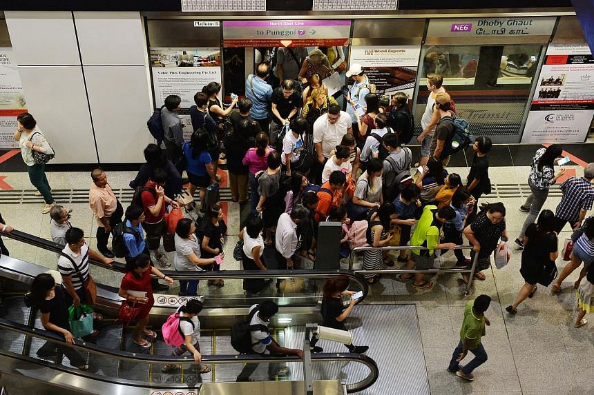 A mobile phone started smoking in a train heading towards Dhoby Ghaut MRT station on the North-East Line yesterday, resulting in the evacuation of the train.