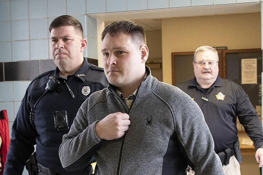 "Mikhy Farrera Brochez being escorted out of the Clark County District Court in Winchester, Kentucky, on Monday. He said the trespassing charge was causing him ""unnecessary hardship""."