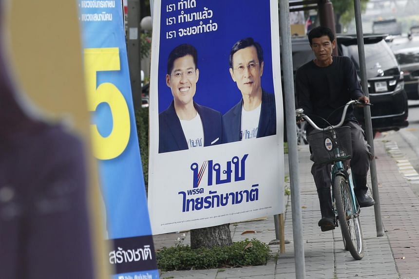 An electoral poster with the pictures of Thai Raksa Chart leader Preechapol Pongpanich (left) and party member Chaturon Chaisang in Bangkok, Thailand, on Feb 14, 2019.
