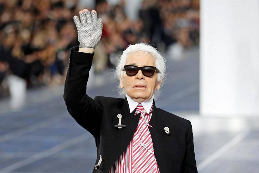 Karl Lagerfeld appears at the end of Chanel's Spring/Summer 2013 women's ready-to-wear fashion show during Paris fashion week, on Oct 2, 2012.