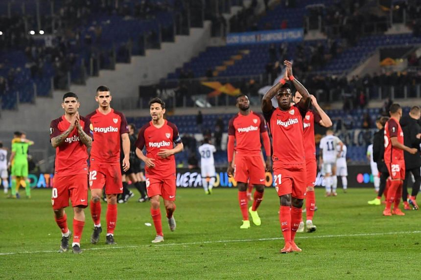 Sevilla's players celebrate the victory at the end of the Uefa Europa League soccer match between SS Lazio and Sevilla FC, on Feb 14, 2019.