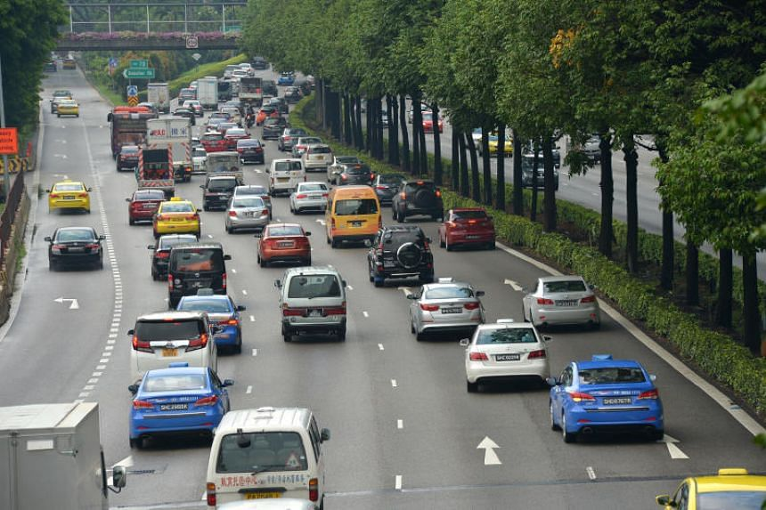 Cars and other vehicles along the Central Expressway near the Jalan Bahagia exit.