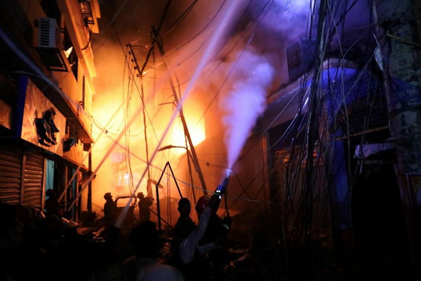 Firefighters work at the scene of a fire that broke out at apartment buildings also used as chemical warehouses in Chawkbazar, Dhaka, Bangladesh on Feb 21, 2019.