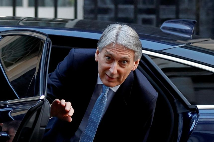 Finance minister Philip Hammond said British lawmakers could be given a vote on a revised Brexit deal as early as next week.
