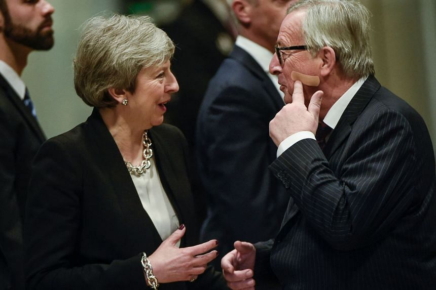 European Commission president Jean-Claude Juncker met British Prime Minister Theresa May in Brussels on Wednesday. He joked that the band-aid visible on his cheek was not her doing.