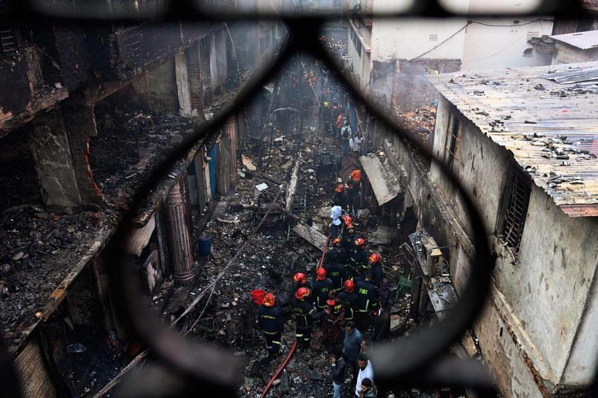 Firefighters are seen at the scene of a fire in Dhaka, Bangladesh, on Feb 21, 2019.