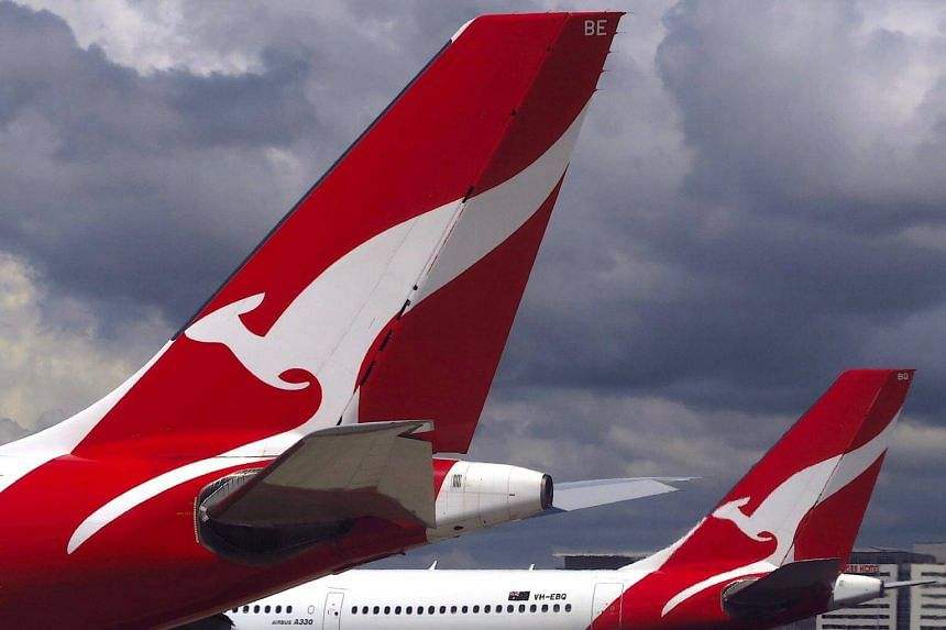 Fuel costs clip Qantas' wings as profits slip