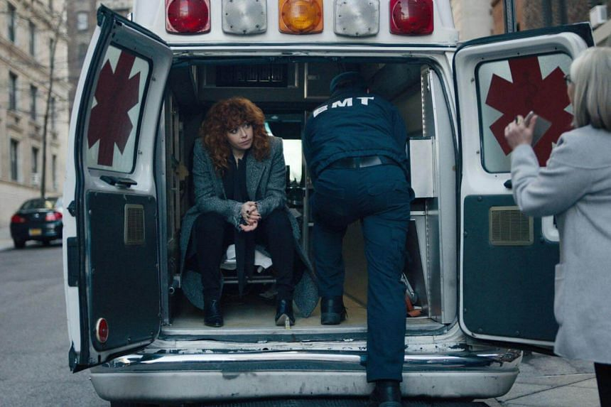 Russian Doll stars Natasha Lyonne as Nadia (left), who dies shortly after her 36th birthday party and finds herself back at the party, reliving the hours before her death.