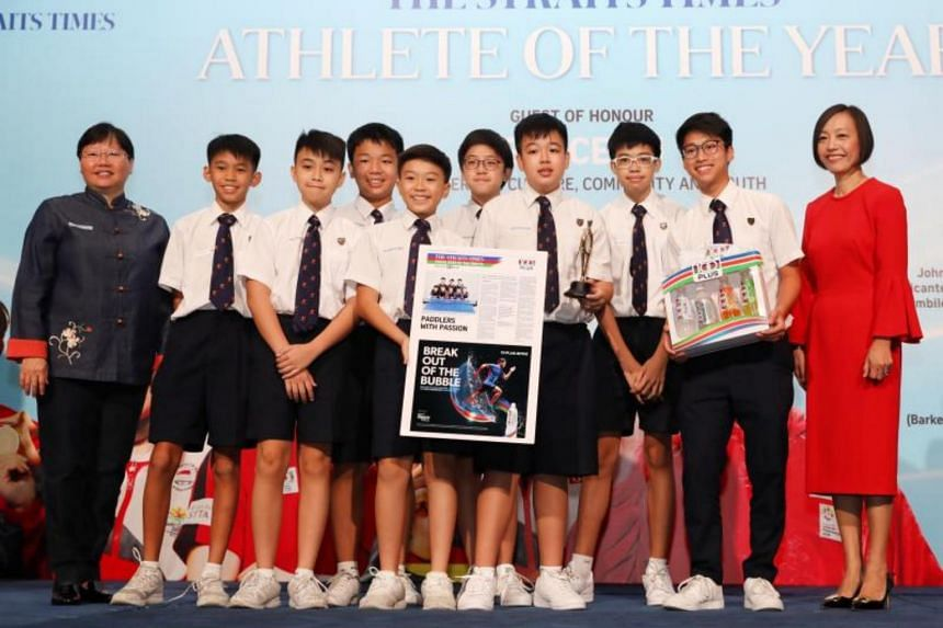 The Straits Times' Young Athlete of the Year nominees from the Anglo-Chinese School (Barker Road) C Division table tennis team receiving the nomination award from ST sports editor Lee Yulin (left) and Ms Jennifer See, managing director, Singapore & Y